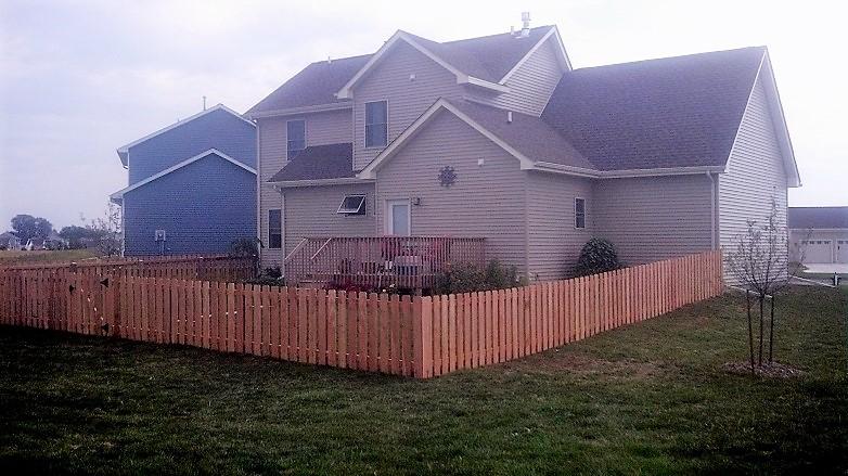 wood fence in iowa home backyard