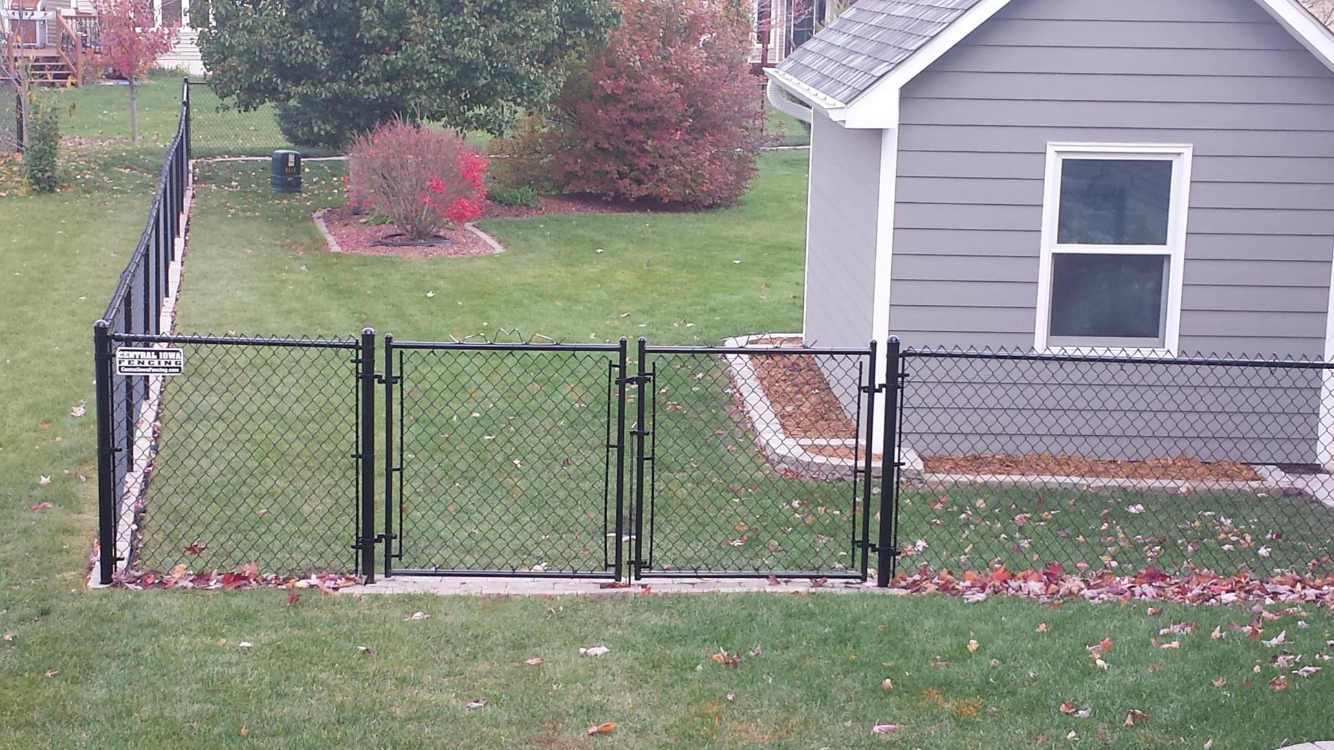 black chain link fence in backyard around shed