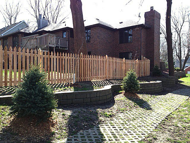cedar gothic fencing in front of executive iowa house