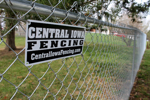 central iowa fencing sign on chain link fence