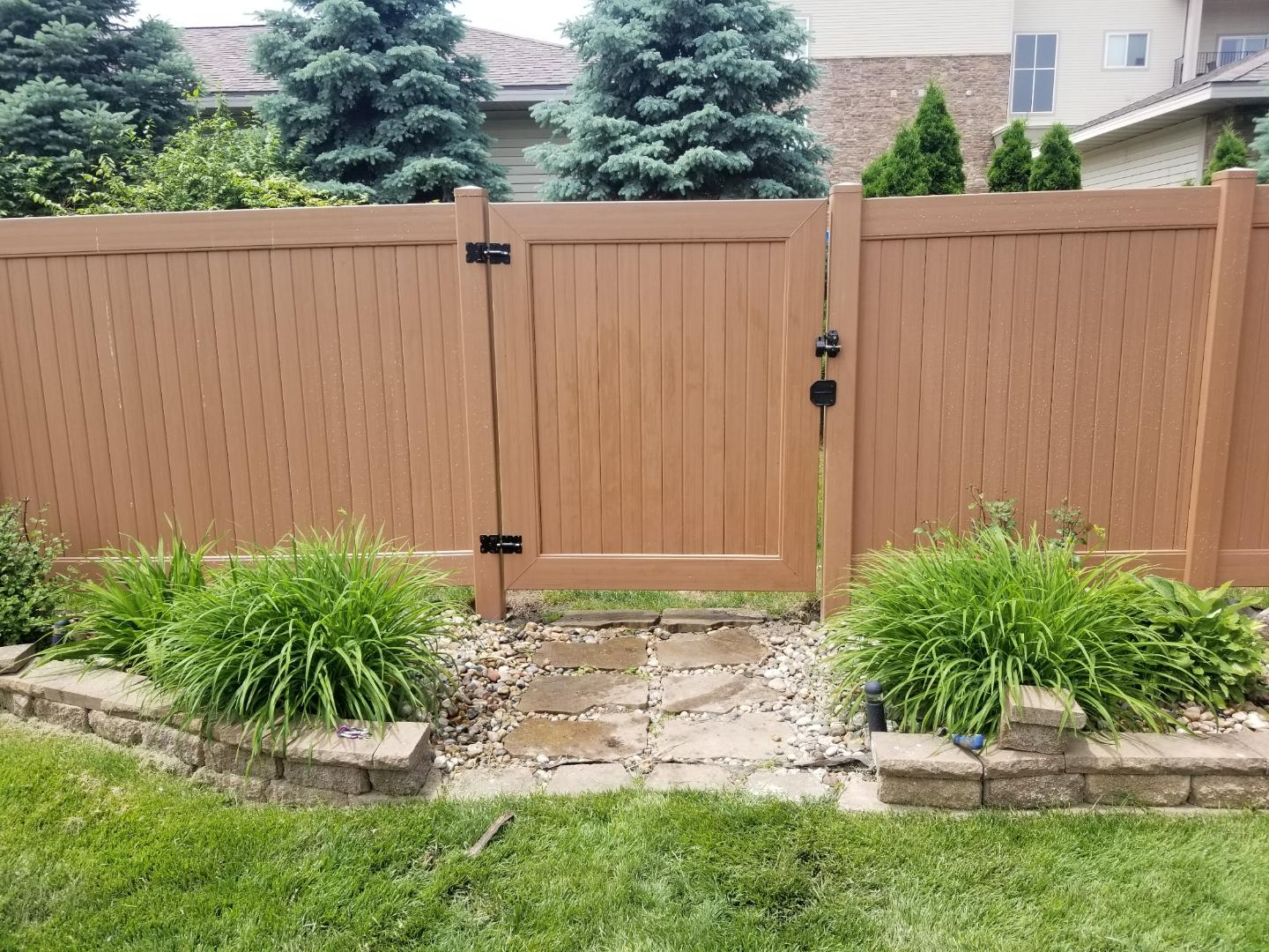 golden oak vinyl privacy fence with gate