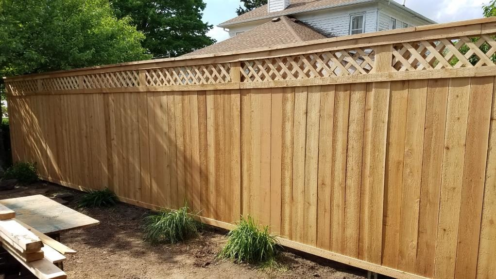 wood privacy fence with lattice top