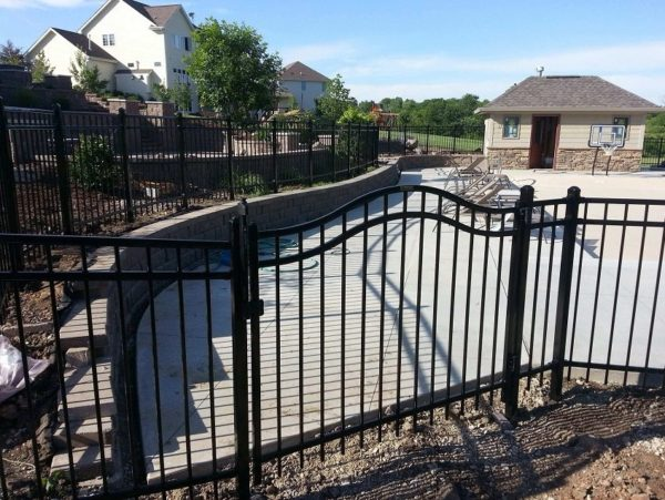 Iron fence header on a residential fence