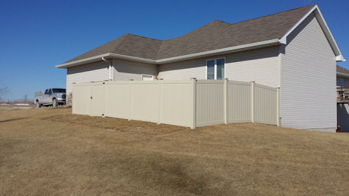 tan colored vinyl privacy fence